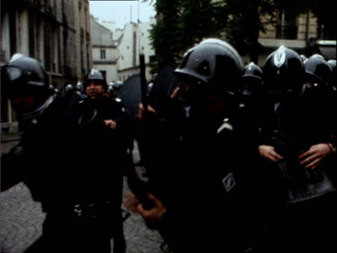 policeman loads tear gas canister into gun and fires towards crowd during student riots paris may 68 - 1968 stock videos & royalty-free footage