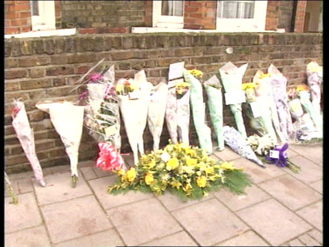 policeman murdered cf england london clapham ms policeman lays flowers at spot where murder took place ms lots of flowers on pavement lms community... - barry took stock-videos und b-roll-filmmaterial