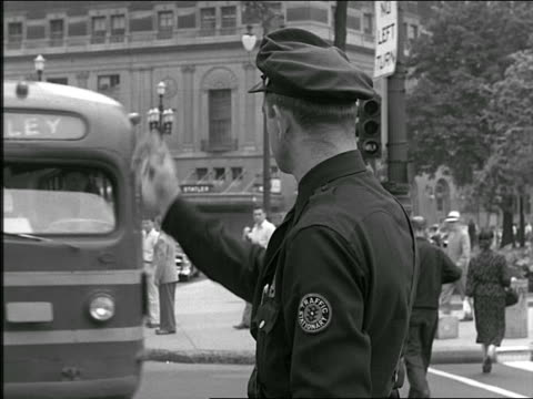 b/w 1952 policeman standing in city street directing traffic - 1952 stock videos & royalty-free footage