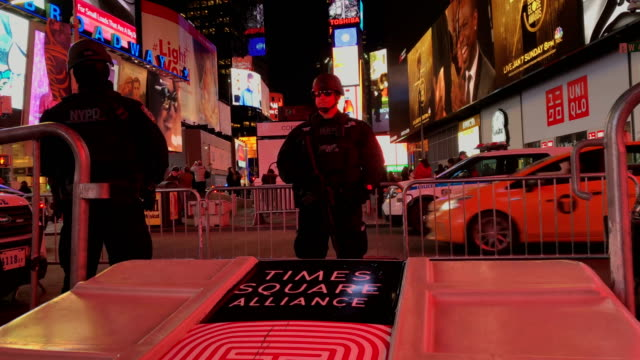 A policeman stands guard in Times Square not far from the site of a pipe bomb explosion on December 11 2017 in New York City Police said that Akayed...