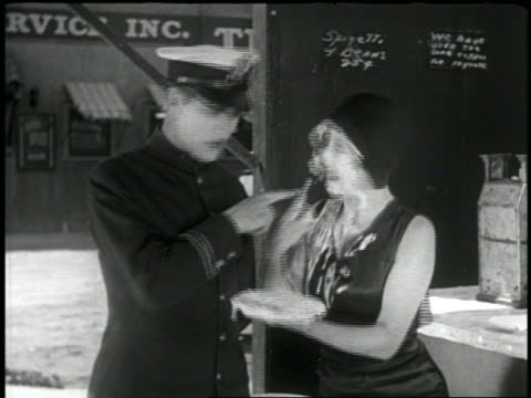 B/W 1920 policeman talking to flapper + laughing / she throws pie in his face / short