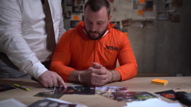 policeman talking with suspect - prisoner orange stock videos & royalty-free footage