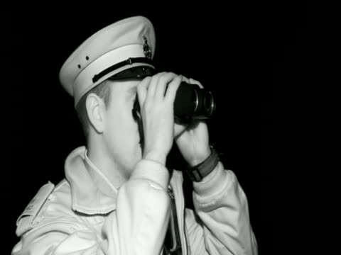 a policeman using night vision goggles as viewed in night vision - skibrille stock-videos und b-roll-filmmaterial