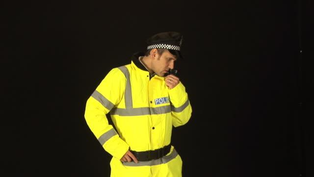 Policeman using radio- HD & PAL
