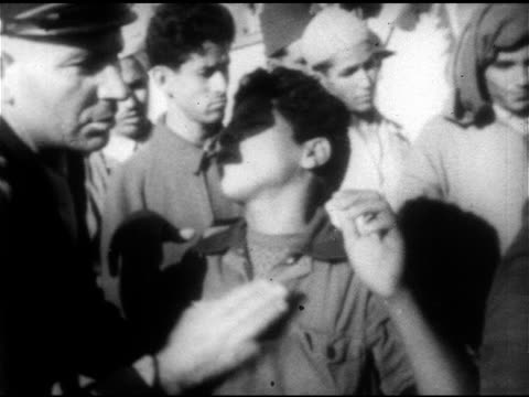 policeman w/ nightstick chasing male small group of males sitting in street ms policeman turning face of young teenager arms up forward ha ws united... - 1953 stock videos and b-roll footage