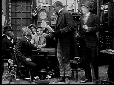 1916 B&W MS policeman walking into room where men are hiding poker game/ man greeting policeman/ card on floor at man's feet/ man showing policeman to the door