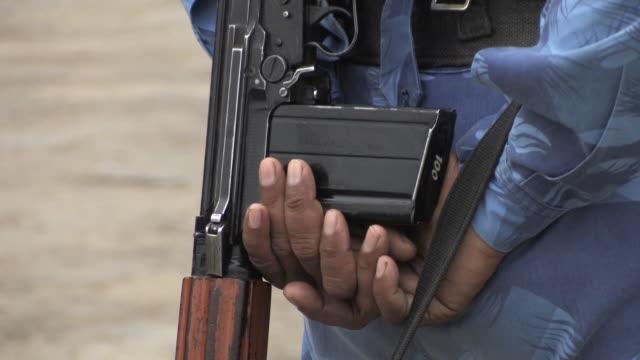 policeman with machine gun taj hotel mumbai india - terrorism stock videos & royalty-free footage