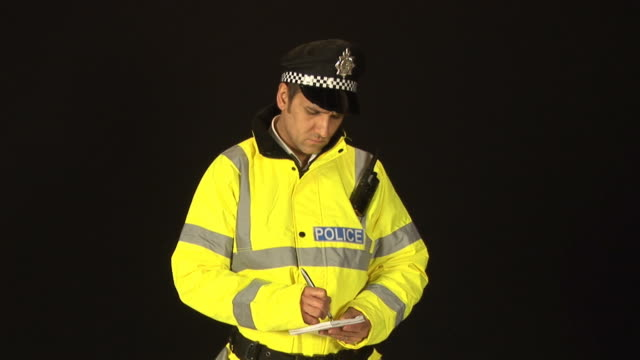 Policeman writing a ticket - HD & PAL