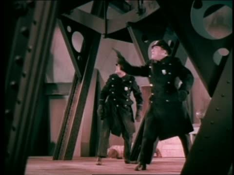 vídeos de stock, filmes e b-roll de 2 policemen / 1 raises gun + shoots - duas pessoas