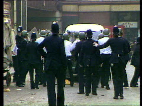 policemen and police van retreat hastily as missiles and objects are thrown during second outbreak of rioting - 1981 stock videos & royalty-free footage