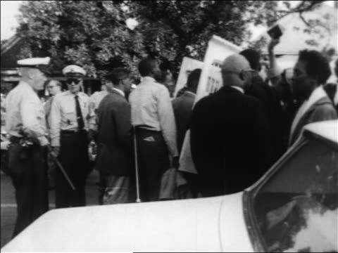 B/W 1963 policemen herding Black demonstrators into paddy wagon at civil rights protest / Alabama