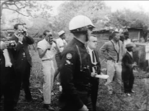 b/w 1963 policemen in helmets at civil rights demonstration / alabama / newsreel - civilian stock videos & royalty-free footage