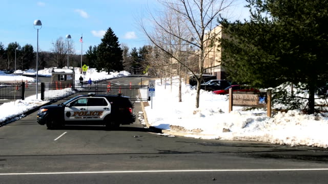 policemen lock down the campus of newtown high school as students take part in the national school walkout on march 14 2018 in sandy hook connecticut... - newtown connecticut stock videos & royalty-free footage
