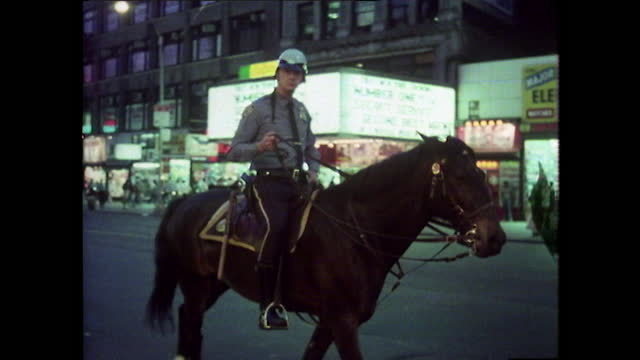 policemen on patrol at night in times square, new york; 1980 - crime stock videos & royalty-free footage