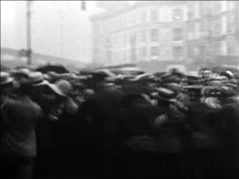 b/w 1926 policemen pushing back crowd in rain on nyc street / rudolph valentino's funeral / news - 1926 stock videos & royalty-free footage