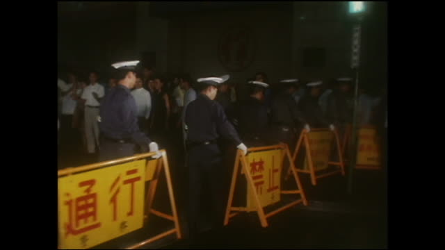 Policemen remove barriers from near Pedestrian Paradise in Tokyo.