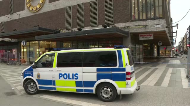 Policemen stand at the scene of truck attack in Stockholm