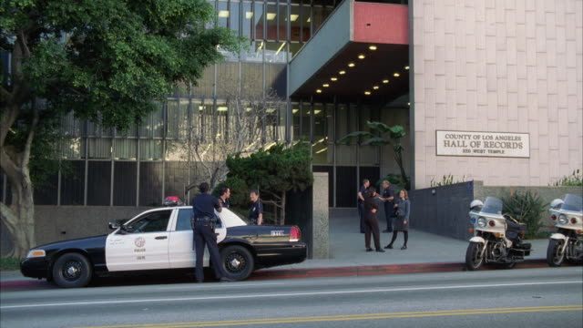 WS Policemen standing in front of Los Angeles Records building / Los Angeles, California, USA