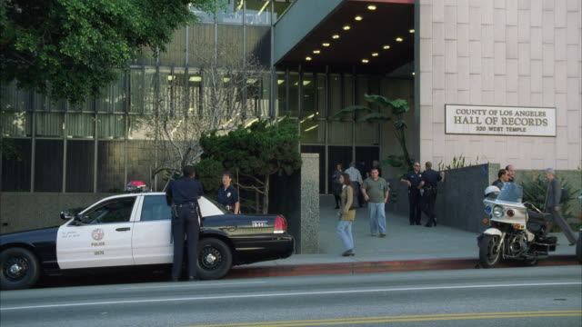WS TD Policemen standing in front of Los Angeles Records building / Los Angeles, California, USA