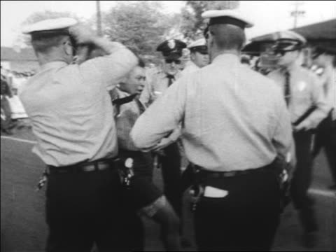 B/W 1963 policemen using force to arrest Black woman at civil rights protest / Alabama / newsreel