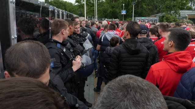 Policemen watch relaxed the arriving fans ahead of the DFB Cup Final 2019 between RB Leipzig and Bayern Muenchen at Olympiastadion on May 25 2019 in...
