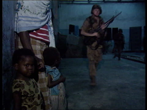 UN policing effort continues SOMALIA Mogadishu MS Group of US Army Rangers of the US Army Quick Reaction Force along CMS More towards MS One towards...