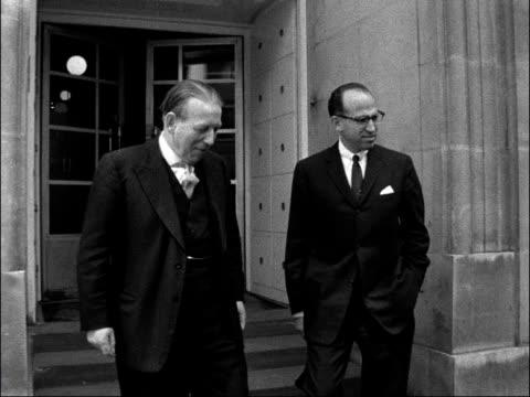 stockvideo's en b-roll-footage met dr salk poses with derek walker-smith outside dept of health; england: london: ministry of health: ext dr jonas salk and derek walker—smith pose at... - polio