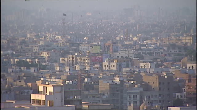 polio epidemic warning karachi skyline showing houses and mosques doctor altaf bosan interview sot - karachi stock videos and b-roll footage