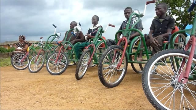 polio survivors in nigeria are learning carpentry and metalwork skills to produce wheelchairs which are helping the lives of disabled people like... - metalwork stock videos & royalty-free footage