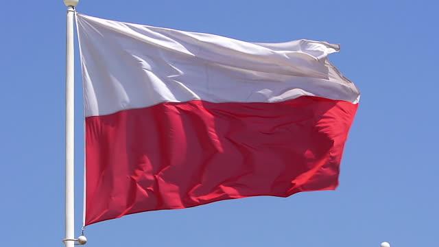 CU SLO MO Polish flag waving in wind / Caen, Normandy, France