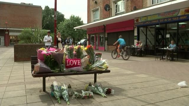 polish man beaten to death in suspected hate crime vigil held in harlow vox pops back view police officers away on street floral tributes and 'love'... - cushion stock videos and b-roll footage