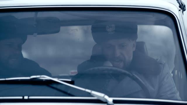 polish martial law 1981. socialist militia patrol in vintage car - 1981 stock videos & royalty-free footage