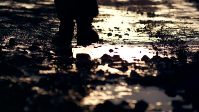 polish martial law 1981. socialist militiaman reflecting in puddle. sunset - rebellion stock videos & royalty-free footage