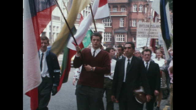 vídeos de stock, filmes e b-roll de polish people march through london in protest at the russian led invasion of czechoslovakia - cultura do leste europeu