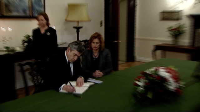 tributes outside polish embassy / gordon brown signing book of condolences int gordon brown mp and sarah brown entering room / gordon and sarah brown... - face down stock videos & royalty-free footage