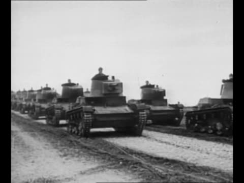 polish soldiers carts mounted soldiers and tanks approach on dirt road as they move toward the frontier as germany invades poland / nazi officers... - poland stock videos & royalty-free footage