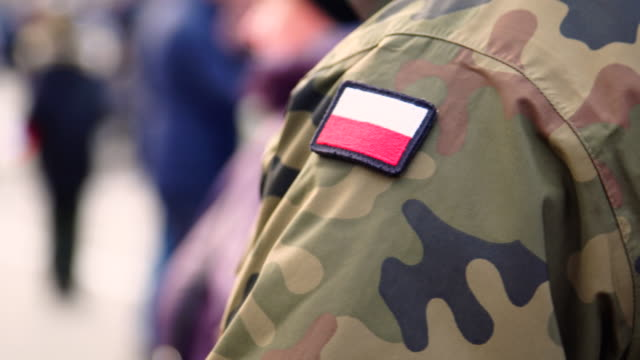 polish solider and flag stripe - military uniform stock videos & royalty-free footage