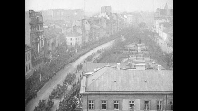 polish troops marching through city street soldiers in uniform rifles shouldered marching in formation tu ws polish military aircraft flying in... - 1937 stock videos and b-roll footage
