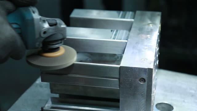 Polishing metal with a tool