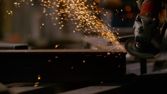 slo mo ds polishing metal with angle grinder - werkzeug stock-videos und b-roll-filmmaterial