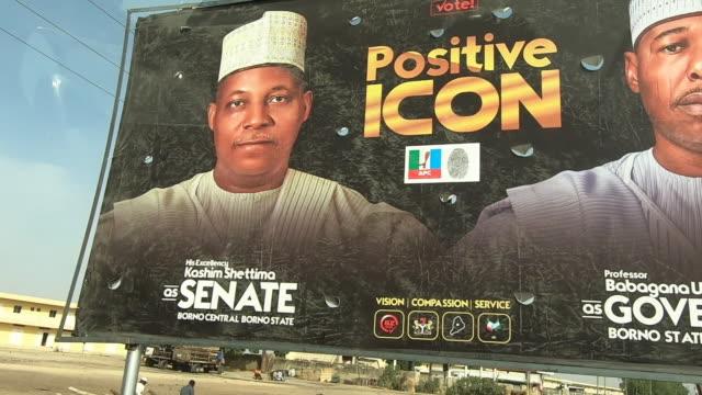 stockvideo's en b-roll-footage met political campaign posters and billboards in maiduguri nigeria - presidentskandidaat