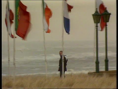 Noordwijk Armed security man along by flags of EC members PAN RL GV Venue of meeting Huis Ter Duin