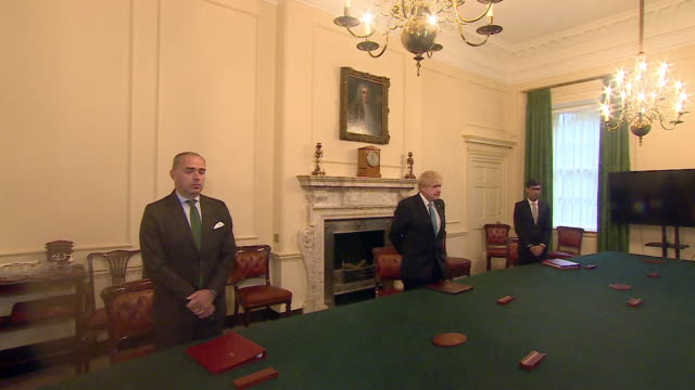 political leaders from all four uk nations observe a minutes silence for key workers who have lost their lives during the coronavirus crisis - monument stock videos & royalty-free footage