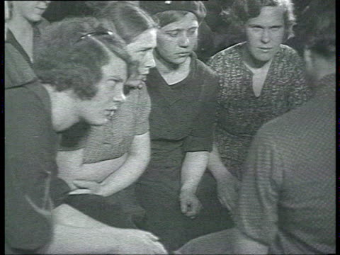 political propaganda in textile factory female workers listening to female party agent and propagandist warning against spies and enemies of ussr... - propaganda stock-videos und b-roll-filmmaterial