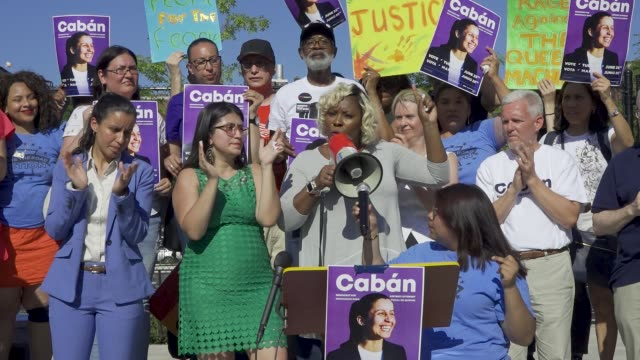 vídeos de stock, filmes e b-roll de a political rally is held for queens district attorney candidate tiffany cabán in travers park in jackson heights queens for the primary day on june... - primary election