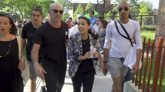 a political rally is held for queens district attorney candidate tiffany cabán in travers park in jackson heights queens for the primary day on june... - vorwahl stock-videos und b-roll-filmmaterial