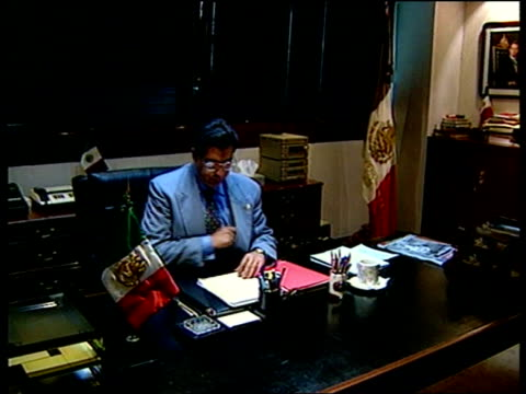 political sleaze; gv exterior of attorney general's office zoom in int: jorge madrazo up to desk and sits and intvw - trust very few cms general... - attorney general stock videos & royalty-free footage