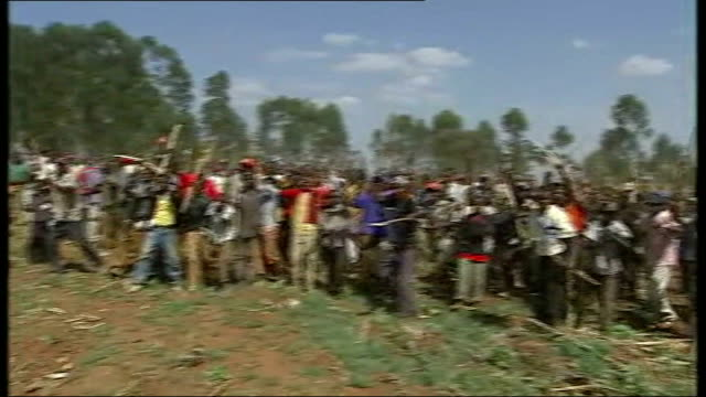 sotik views various of burning village buildings air view tea plantation clearing with crowd of kenyan men running ext crowd of kenyan men... - burning mattress stock videos & royalty-free footage