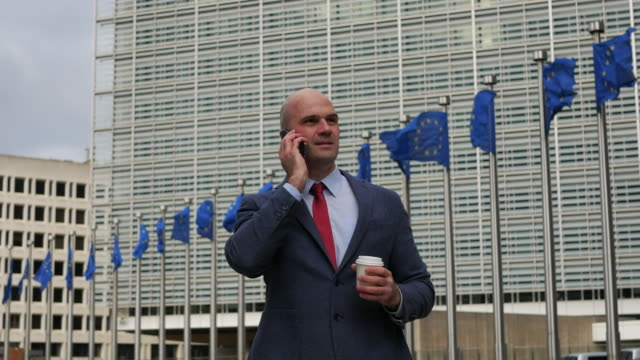 Politician in European Commission building - Berlaymont. Successful administrative person working in Brussels