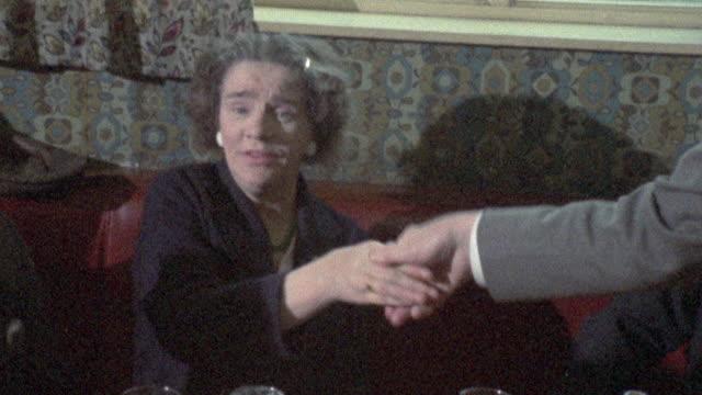 vídeos de stock, filmes e b-roll de 1973 ts politician shaking hands with voters / belfast, ulster, northern ireland - província de ulster